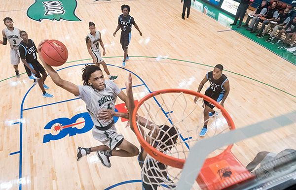 Shelton State Basketball Player Dunking Mid-air