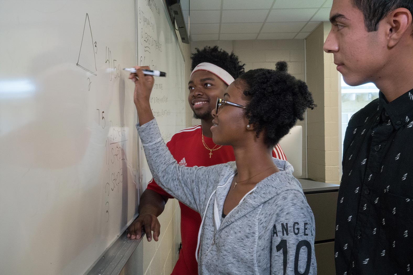 Trenholm Swift students practicing math on a whiteboard