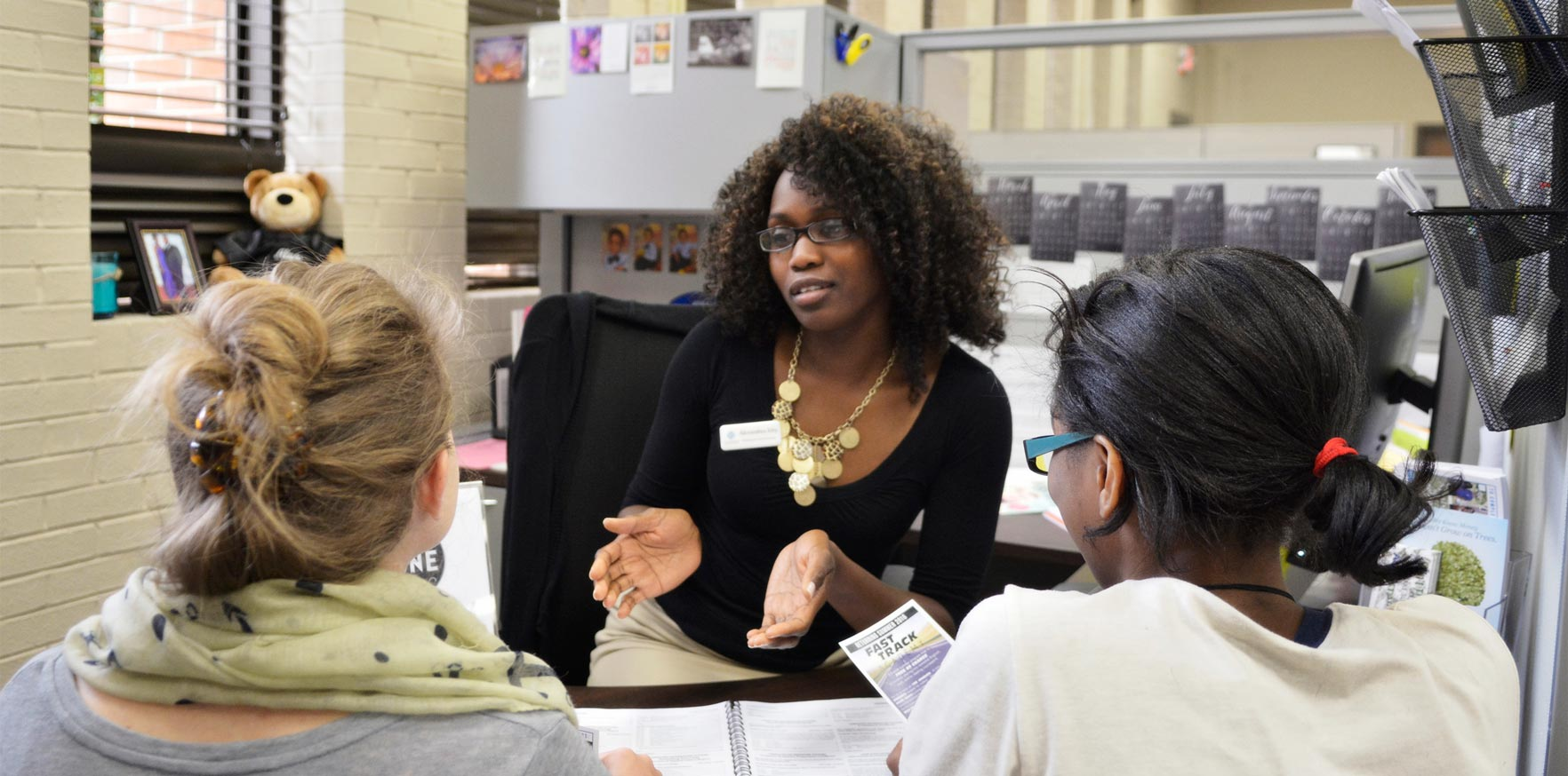 Female counselor giving information on how to apply