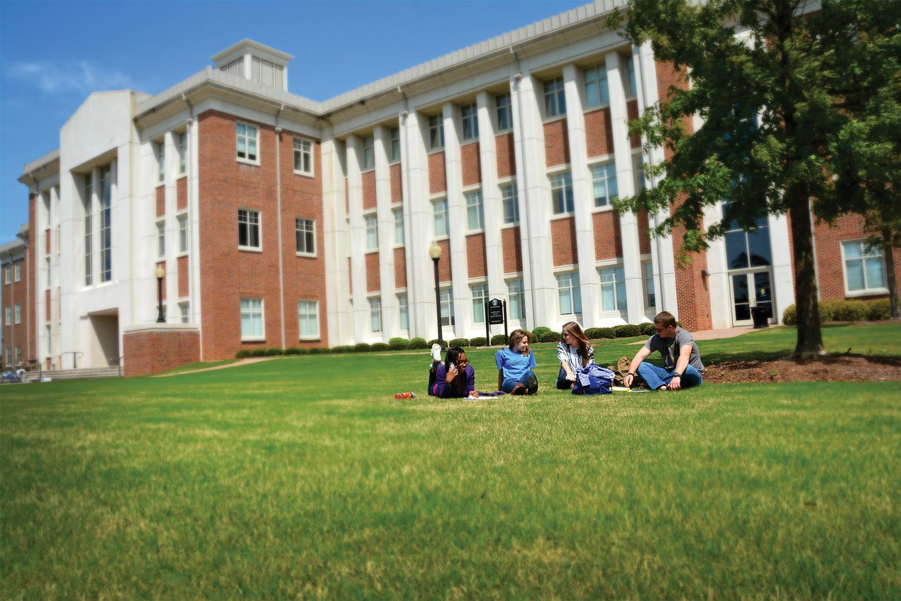 Student Life Image of students sitting on the grass on the Calhoun campus