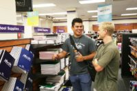 Two students conversing inside of the Jefferson State Supply store