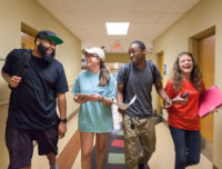 Students laughing in the hallway