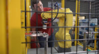 Technical Training male observing robot